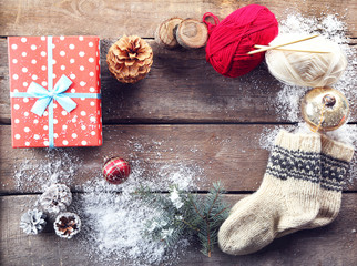 Christmas composition with socks, gift box and decorations on a wooden table