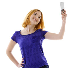 Young attractive woman taking selfie with mobile phone isolated on white