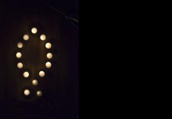 Candles in Ichthys motif on hardwood floor