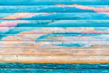 Section of coloured wood panelling from a beach hut, suitable for backgrounds of beach, seaside and summer holiday themes.