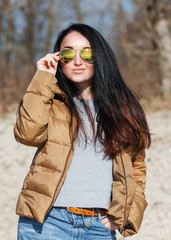 Brunette in down jackets and mirror glasses