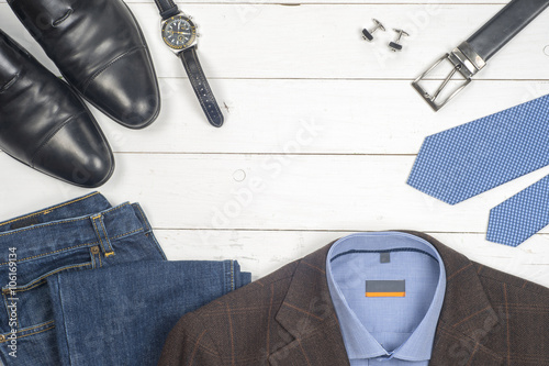set of men's clothing and shoes on wooden background. Men ...