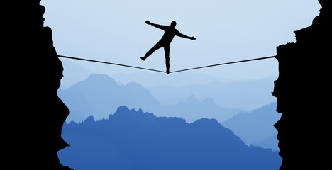 Man balancing on the rope risk taking and challenge concept