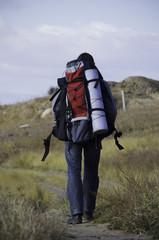 A tourist walks along the trail