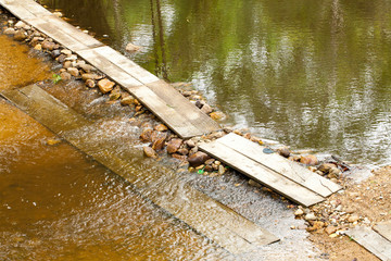 bridge, hand made wood bridge crossing over water stream in forest