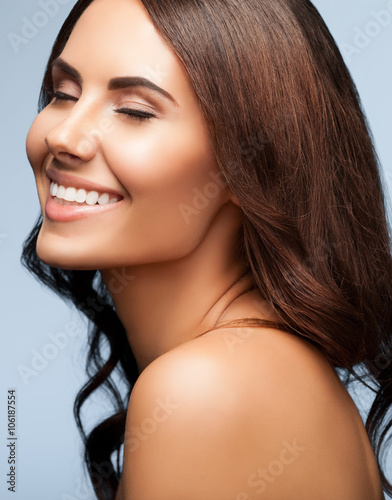 Young Woman With Naked Shoulders, On Grey Stock Photo