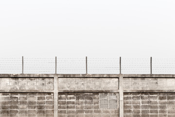 fence with barbed wire above