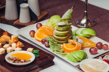Fruit salat mix, fruit dessert - pear sliced, pineapple, strawbe