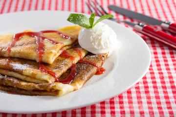 pancakes on white dish