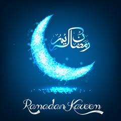 Ramadan Kareem on blue bokeh crescent