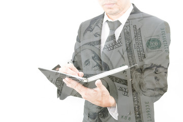 Double exposure of businessman with pile of dollar planning in b