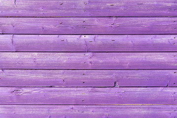 Section of purple wood panelling from a seaside beach hut. Could be used as a background to illustrate beach and summer holiday themes.