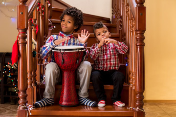 Kids playing music on stairs.