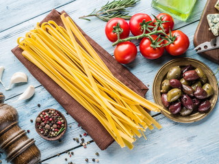 Tomatoes, spaghetti pasta and spices.
