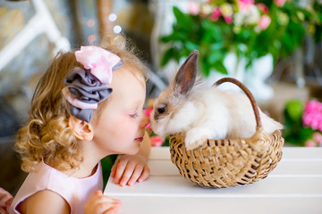 little girl with a rabbit