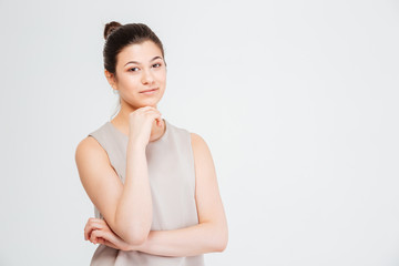 Smiling attractive young business woman with hands folded