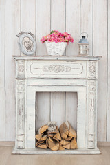 Vintage white fireplace with firewood