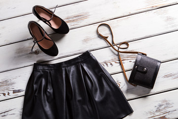 Woman's dark skirt and footwear.