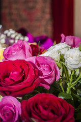 Beautiful gift bouquet of pink, red and white roses