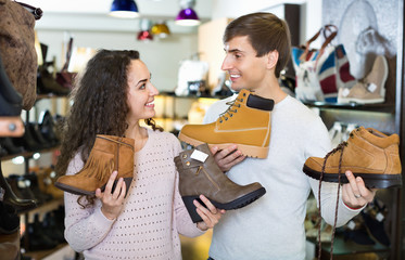 Couple buying winter shoes in a shoe store