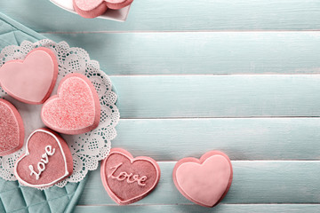 Assortment of love cookies on wooden table background