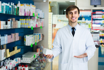 Portrait of male pharmacists working in modern farmacy