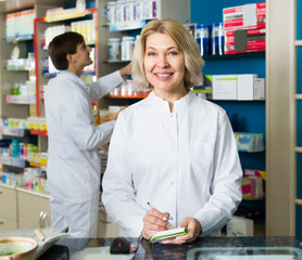 pharmaceutists working in chemist shop