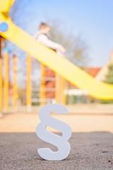 White paragraph symbol on children playground