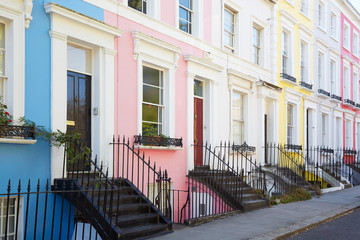 Colorful English houses facades in blue, pink, yellow and white