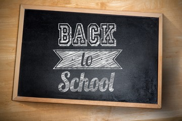 Composite image of back to school against chalkboard