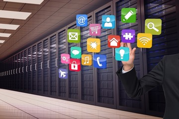 Composite image of businessman touching apps
