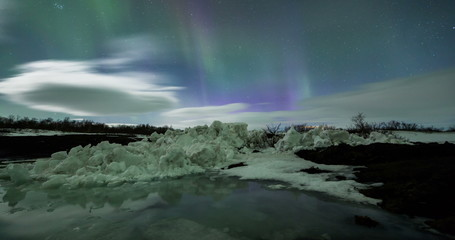Wall Mural - Northern Lights above an iceberg Lagoon