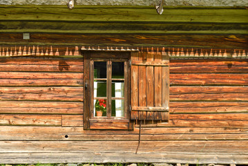 Window in wall of old wooden house