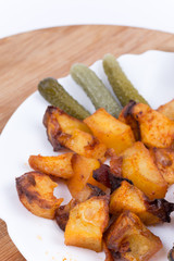 Roasted potatoes in the plate
