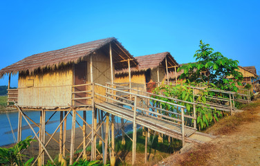 Wooden houses built on high stilts called in Chitwan, Nepal