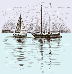 sailing yachts in the bay