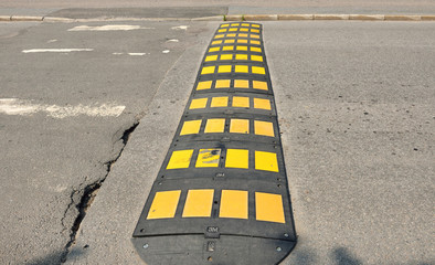 Speed bumps are common name for family of traffic calming devices that use vertical deflection to slow motor-vehicle traffic in order to improve safety conditions