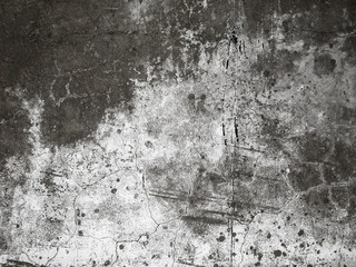 Cracked plaster on the wall. Grunge texture