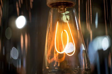 Close up Light bulb over dark background