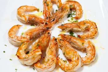delicious cooked prawn plate served with olive oil on white background