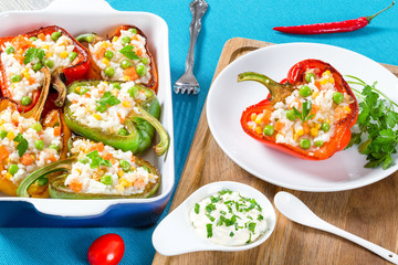 bell pepper stuffed with rice, green peas, carrots, top view