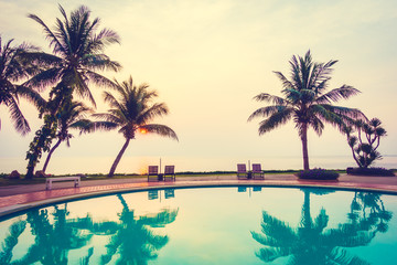 Silhouette coconut palm tree with swimming pool