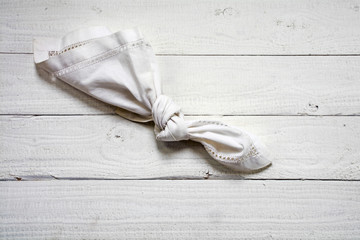 reminder, knot in an old  handkerchief on white painted wood