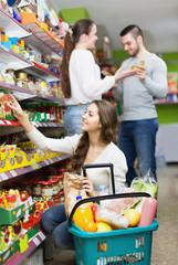 Positive adults choosing tinned food