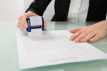 Businesswoman Stamping Contract Paper