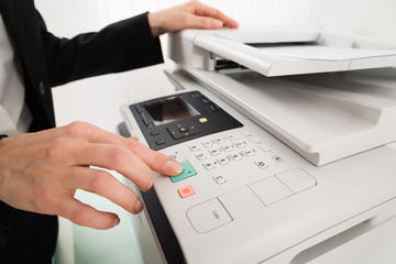 Businesswoman Hand Pressing Printer's Button