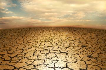 Cracked soil earth desert terrain with sky