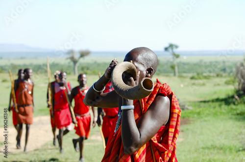 Wall mural Masai Kudu Horn Blowing - Kenya
