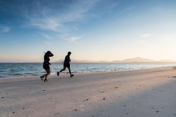 silhouette running on the island beach
