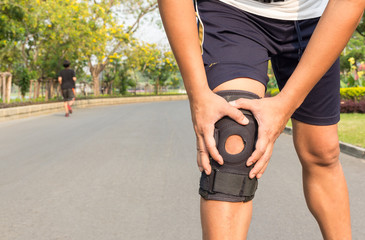 close up of knee support brace on leg at public park